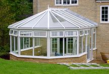 Brockhampton 2000 / We needed to dig out a large proportion of the raised lawn area to make room for the conservatory. Once finished, a small Cotswold stone retaining wall was built, providing a walk-way around the conservatory and giving a handsome finish to the whole project.