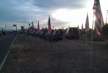 "7th Annual ""Flags for our Fallen"" Memorial Day Tribute / Motorcycle Patriots honor our fallen veterans and their families with over 150 motorcycles and flags lined up along the entrance to the Phoenix National Cemetery."
