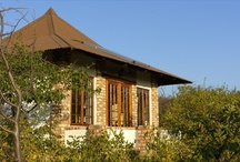 Etosha Safari Lodge / Guests rave about the view: the restaurant and chalets, situated on a hillock, offer magnificent views of the African bush savannah. There are 65 double room chalets with a choice of three swimming pools between them. Apart from the restaurant and bar there is a wooden platform for sundowners high above the Mopani bush. The Andersson Gate into Etosha National Park is a mere 9 km away. Those who do not want to drive themselves can join one of the lodge's daily safari trips into the park.