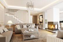 Aranżacja wnętrza salonu w stylu Hampton - Tissu. / Wystrój wnętrza salonu w rezydencji pod Warszawą. Aranżacja wnętrz luksusowego, otwartego salonu, wykończonego drewnem z narożnym kominkiem.