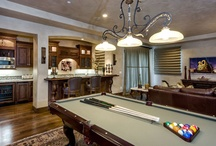 Man Caves / Cool rooms or spaces (as in a basement or built-out attic) designed according to the taste of the man of the house. A Man Cave is to be used as his personal area for hobbies and leisure activities and gathering with his friends.