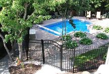 Favorite Pool Fences  / These are our favorite pool fence pictures. Most states require a fence around a pool area, so why not make it look great!