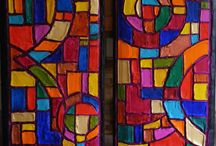 Faux Stained-Glass Window Paintings / Love the glorious glow of stained glass, but don't the right windows, space or light? My solution: create paintings that look like stained glass by upcycling cedar fence planks as canvas, hand-sculpting beautiful geometric stained glass patterns using joint drywall compound and painting in bold acrylic colors. Looks like the real thing without light or windows!
