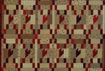 brown quilts / by Carol Mercer