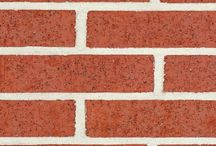 Red Wirecut Ironspot   Triangle Brick Company / In a similar style to our Red Wirecut brick, Triangle Brick Company's Red Wirecut Ironspot brick provides our customers with an unforgettable, distinguished look suited to architectural projects of all scopes and sizes, from expansive office parks to small commercial businesses. Offered under our Standard product tier, this classic red architectural brick features small, black ironspots for added texture and interest.