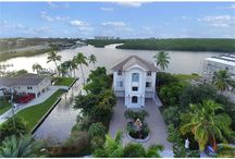27693 Bay Point Ln, Bonita Springs - House For Sale / MLS #: 215063127 Price: $ 2,700,000 Year Built: 2004 Living Area: 6,082 Sq. Ft. Bedrooms: 4 Bathrooms: 4 Garage Spaces: 2 Pool: Yes Water Front: Yes  Mesmerizing Wide Bay Vistas and Signature Florida Sunsets Abound from this Magnificent Gulf Access 4 Story, 4 Bedroom, Nearly 6,000 Sq. Ft.
