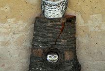 Eule auf Holz stein