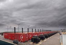 Obra Civil Power Plant Angola / Diseño, proyecto y dirección de Obra Civil para Power Plant de 20 MW en Cassaque, Luanda. Movimientos de tierras, explanaciones, cimentaciones y soportes de hormigón armado, para dar cabida a 18 grupos electrógenos de 40 pies y 11 depósitos de combustible de 50.000 litros cada uno. Instalaciones soterradas, soleras, oficinas y vallados.