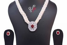 Braided Pearl Necklace Set in Seed Pearls and Ruby Pendant at Rs. 5,300