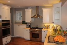 Kitchen Remodel / This beautiful kitchen remodel project recently completed in Kenilworth, IL included new DesignCraft cabinets, limestone countertops and a glass tile backsplash all purchased at Lewis Floor & Home.