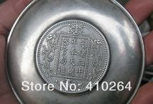 Chinese silver bowls with silver dollars / (some are not genuine coins)