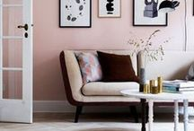 Pink walls with modern art and mixed color decor. So…