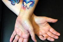 M & D  tattoos.