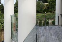 Unique deck designs / Curved glass deck railing
