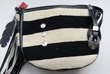 Designer Leather Handbags / Designed by Pat Charley for PCco. Handbags, this bags has it all!  Striped vintage Navajo inlay, exquisite leather, coin conchos, leather feather.  Others will ooooh and ahhh when they see you carrying this exquisite handbag.