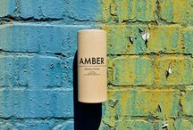 AMBER / AMBER: Balmy layers of wood and ambergris, with green spicy top notes. Awaken the senses with this most modern fragrance.