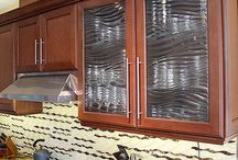 Cabinets / Glass cabinets for your home or office space are a perfect alternative. Whether inserts or frameless glass doors, let cabinets become a focal point of the room.