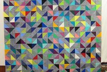 Modern HST's.  Love 'em or Hate 'em. / HST's are so versatile.  Look at all of these AMAZING modern quilts made with this block.