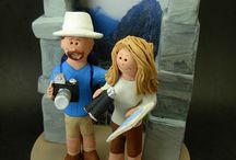 "Travellers and Backpackers Destination Wedding Cake Toppers / Travellers Wedding Cake Toppers - Custom Made... whether the bride and groom are travelling 1st class or backpackers. These personalized figurines are hand sculpted to the clients specifications. The globetrotting couple can be in gown and suit or casual attire, holding tickets passports and visas or anything you want...a  personalized gift that crosses the boundaries of a regular wedding cake topper, into the exotic land of the ""one of a kind"" matrimonial figurine and keepsake!   magicmud.com"