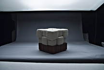 cubes / A pattern of 18 crocheted cubes placed on a wooden base. Meranti striped platform contrasting with the cotton seat.