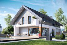 HomeKONCEPT 11 | Projekt domu / HomeKONCEPT-11 to projekt urokliwego domu jednorodzinnego, który łączy w sobie ponadczasową nowoczesność wykończenia z praktycznym rozwiązaniem wnętrza. Prostą, geometryczną bryłę przełamuje garaż wysunięty przez lico budynku. Nad wysuniętym fragmentem garażu zaprojektowano przytulny taras. Skryte w bryle budynku wejście do domu zdobi szeroki filar oraz para intrygujących, podłużnych okien.