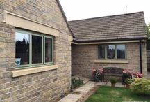 Maytree Gates 2016 / Moorland Green aluminium windows in a gated road in Bishops Cleeve