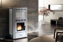 Grey wood Pellet Stoves and interior design inspiration / Pictures of grey wood pellet stoves. Pictures of wood pellet stoves that compliment grey as an interior design colour.