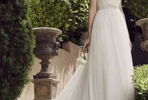 """A-line Wedding Dresses / The A-Line wedding dress features a skirt that gradually begins to flare out from a fitted bodice, starting below the natural waist, and lightly skimming the hips, as it and extends to the hem, forming an """"A"""" shape."""