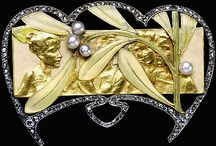 Art Nouveau Jewelry (Dawn's) / The Art Nouveau period (1890 - 1910) produced some of the most evocative pieces in the history of jewelry design. Central to the movement was an embrace of romanticism, naturalism and femininity. The use of flowing, curvilinear lines with attention to balance and symmetry is of paramount importance within Art Nouveau pieces – both in jewelry and other forms of art. / by Dawn Chung