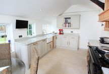 Charm & Character / Classic Oak and hand painted kitchen with Pippy Oak (Cats paw) oak panels in the doors and oak and brushed steel handles.  www.rencraft.co.uk