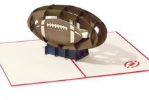 Football / America's favorite game inspired us to create a football card to delight and surprise even the manliest of men.  Show your love for the game with LovePop's unique football paper pop up card as an invite to your next Monday night football party!