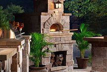outdoor fireplace / by Laura Souyoultzis