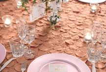 Blush Pink + Gold Textured Wedding / This clean, elegant wedding theme was all about romance. Exquisite gold Peacock Tablecloths exuded texture and opulence. Glass tealight votives provided a gorgeous ambiance for beautiful, cascading florals, created by Stem Design. Each place setting had Blush Pink Charger Plates and customised golden menus to compliment the custom table numbers. The ivory draping and 15 light chandelier finished the room perfectly, illuminating it and adding a sense of extravagance.  www.enchantedemporium.com.au