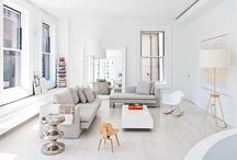Living Area Layout / 1) Neutral hues -- whites, blacks, grays and cognac with pops of color.  2) Comfortable seating for a larger group of people -- smaller seating in the form of one seaters (can use the seats we already have, or replace with accent pieces) 3) A good rug to pull it all together 4) Plants to liven up the space a bit. Anything that is a bit low maintenance is better. 5) Comfortable stools for the kitchen island. Additional seating for the dining area.
