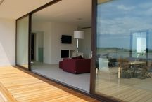 EBE 85 AS Steel Framed Lift and Slide Doors / Creating a modern lift and slide door from thin thermally broken steel frames, you can create a bespoke patio door design from steel, Corten Steel or Architectural Bronze with IQ Metal frames.