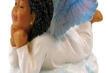 Decorating a Christmas Tree with a Ethnic Angel Theme / This board displays ethnic Christmas tree ornaments for decorating a Christmas tree with a African American angel theme.