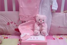 Keepsake gift boxes / Each box is filled with baby clothes and toys for a babies first few months.