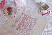 sew, a needle pulling thread