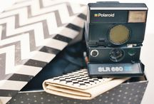 Polaroid is the new black / A true delight, a mysterious box that once opened will give its owner seductive charms and powers, power to capture great moments, whether you imagine yourself in Twin Peaks, or at a masquerade ball. Or both.