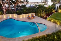 Feature Project | Tropical Persuasion / The clients wanted a lush, tropical style garden with lots of colour and variety. Working with the existing pool shell, Twill architectural concrete pavers were used for the coping units and pool surrounds.  Additional surrounding areas were paved in La Roche limestone to offer texture and character to the area while seamlessly blending with the existing sandstone path. Mass planting of colourful foliage was carried out to achieve the lush green effect typical of a tropical style garden.