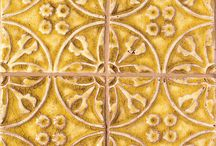 Provence Ceramic Tile / Ornamental detailing, museum quality glazes, and wonderful patterns influenced by the artisan's travels throughout the Loire Valley, make our Provence Collection the center of attention in any room. The evidence of the passion infused by the artist is everywhere. With more than 16 rich glazes to choose from, the Provence Collection is perfect for a kitchen backsplash, light use counter tops, bathroom and shower walls, fireplace surrounds, and outdoor fountains in mild climates.