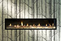 Fireplace Design & Decor / Dress up your fireplace with wall paper, artwork, ornaments and more!
