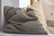 MAOMI | Cushion SELMA / Cushion SELMA is made out of undyed, natural virgin wool and filled with goose and duck feathers. The wool originates from a Romanian village we are collaborating with. Through our purchases the residents are able to make small investments in their infrastructure.