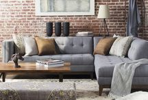 Utilitarian / Raw spaces designed for urban living are made inviting through purposeful design and menswear inspired textiles. Colors and materials enhance natural brick and concrete surfaces, creating warmth and familiarity.