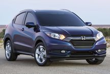 """Zachary's car one day / This looks to be a nice safe car for a young driver. Honda HR-V, AWD, EX-L Navi Continuously Variable  Color blue. 17"""" wheels, mud flaps, cargo cover and mat."""