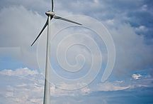 Eolian windmill in Dobrogea county surounded by crops on a dramatic sky