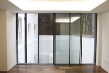 Juliette Balconies / examples from IQ Glass of contemporary glass Juliette balconies. Mixing frameless glass balustrades with opening doors. Great for use on the upper floors of contemporary designs