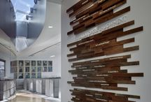 Mural Wall / This is a wall that, unlike the other ones, does not serve a function besides adding aesthetics to the space, wood elements, and can be considered an extension of our Identity Wall – listing out our shared values: compassion, integrity, etc.