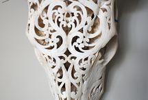 Carved cow skulls