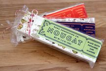 Nougats / Chances are you have had nougat before, so what makes our nougats different? We mix in the same candied fruit use for our calissons into our nougat to give your tastebuds an extra kick of flavor. We also offer tantalizing combinations including Black Olive Pistachio Almond, Candied Fruit Almond, and Coffee Pretzel Macadamia Cocoa Nib.